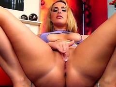 Pretty young blonde girl Paige Turnah is demonstrating sexy yummy butt and then gets on the Davenport in doggy pose and masturbating her twat.